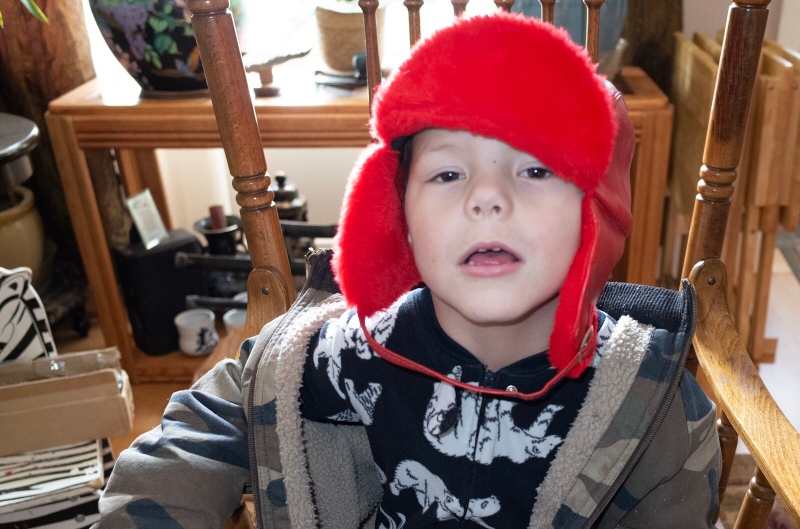 Chris Wessells street photography kid in a winter hat